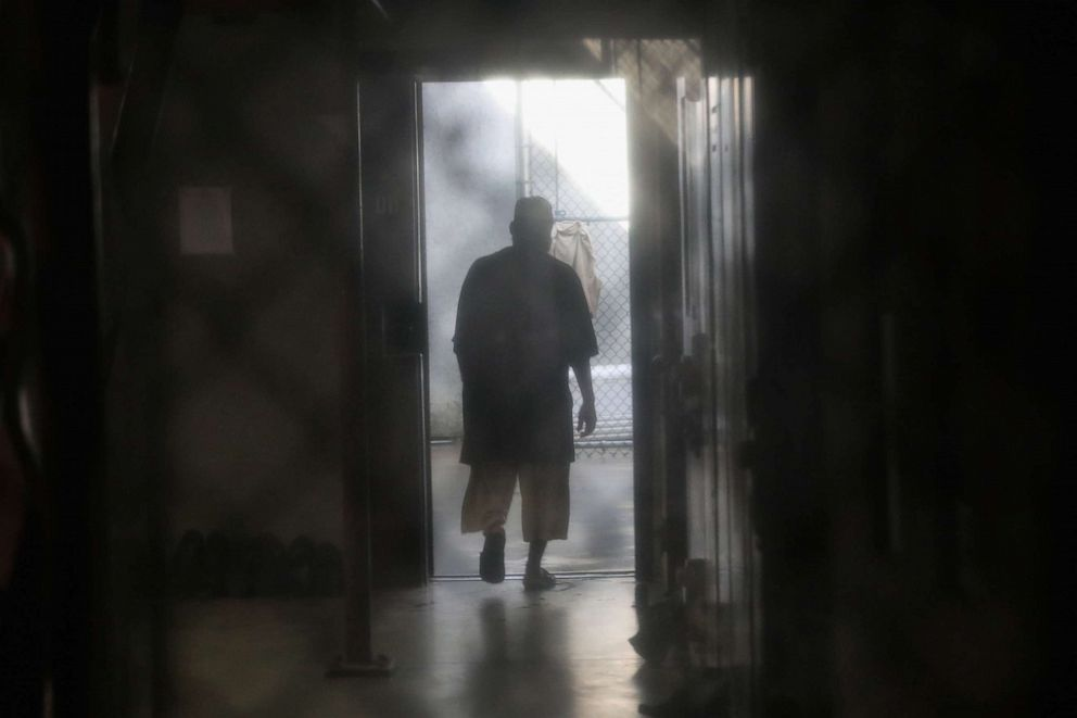 PHOTO: A prisoner walks to an outdoor area of the Gitmo maximum security detention center on Oct. 22, 2016 at the U.S. Naval Station in Guantanamo Bay, Cuba.