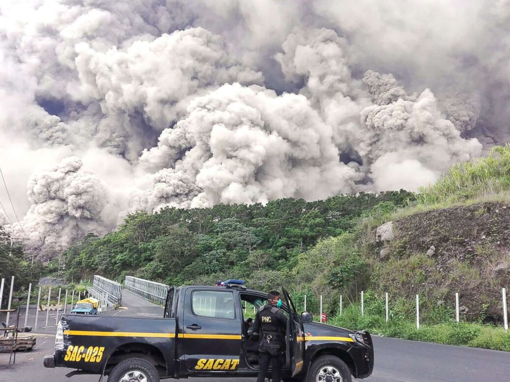 PHOTO: A policemen is pictured during search operations around Fuego volcano after an eruption in Guatemala, June 3, 2018.