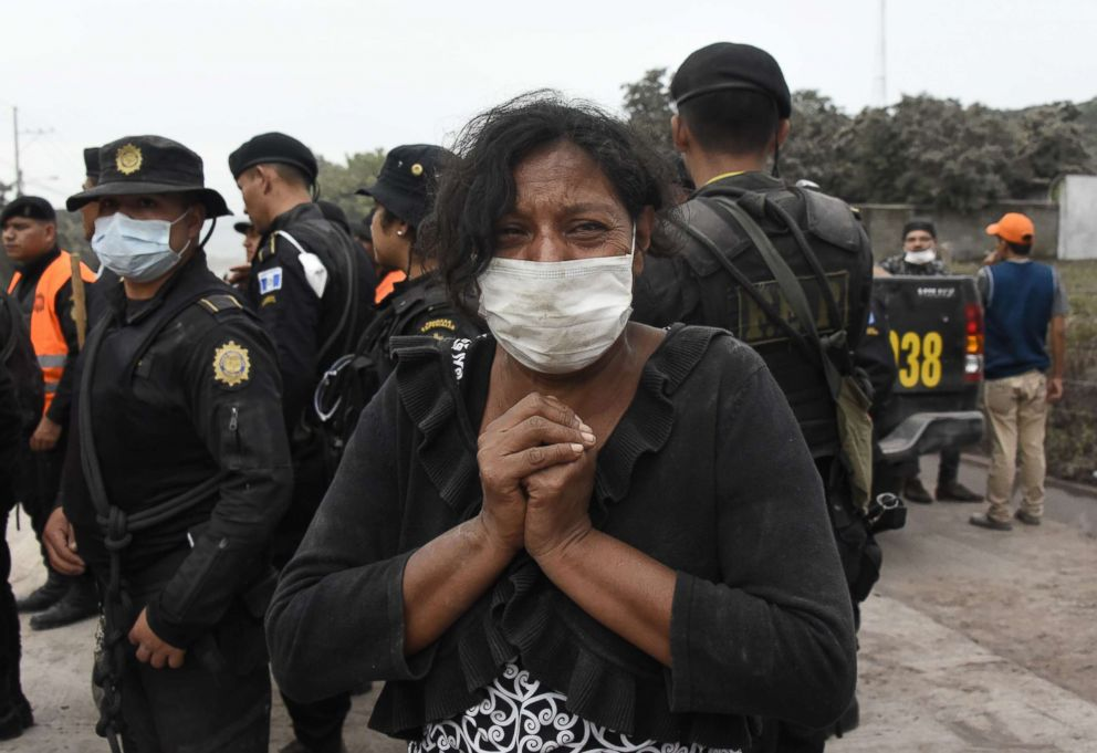 PHOTO: A woman cries for her missing relatives during the search for victims in San Miguel Los Lotes, in Escuintla, Guatemala on June 4, 2018, a day after the eruption of the Fuego volcano.