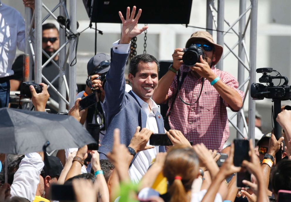 PHOTO: Venezuelas self-proclaimed interim president Juan Guiado greets the crowd during an event to swear in nurses, doctors, that will help with the arrival and distribution of humanitarian aid in in Caracas, Venezuela, Feb. 16, 2019.