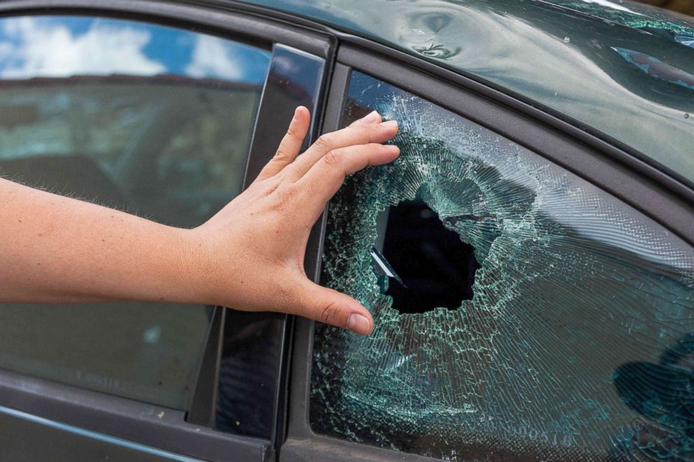A resident's hand shows the damage to a window of vehicle in the village of Saint-Sornin, July 5, 2018, after violent hailstorms ripped through the area some 50 miles north-west of Bordeaux in western France late July 4.