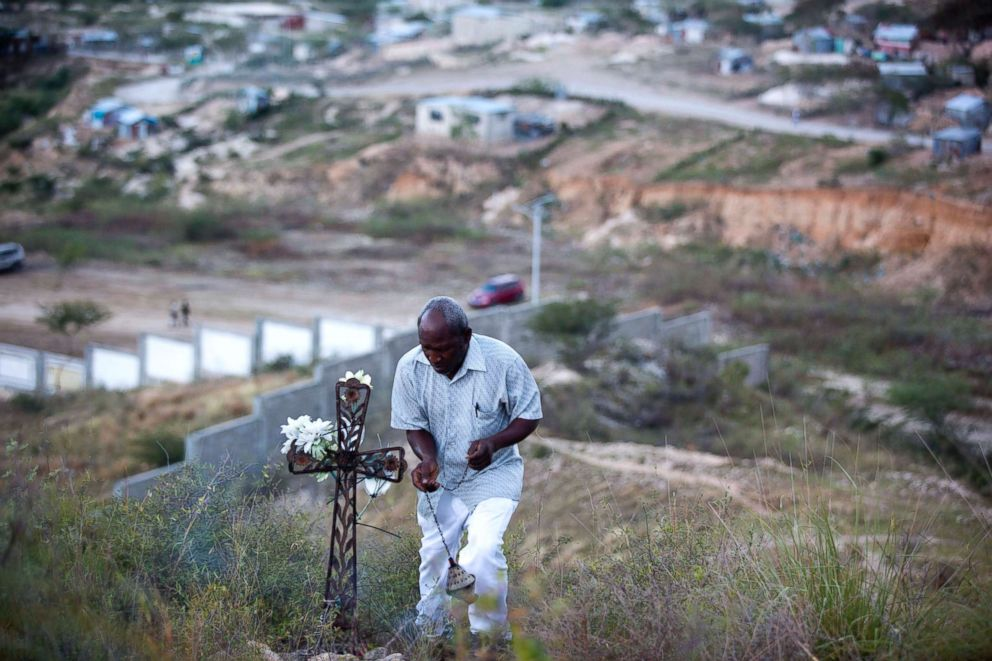 PHOTO: A man performs a voodoo ceremony before the start of a memorial service honoring the victims of the 2010 earthquake, at Titanyen, a mass burial site north of Port-au-Prince, Haiti, Jan. 12, 2018.
