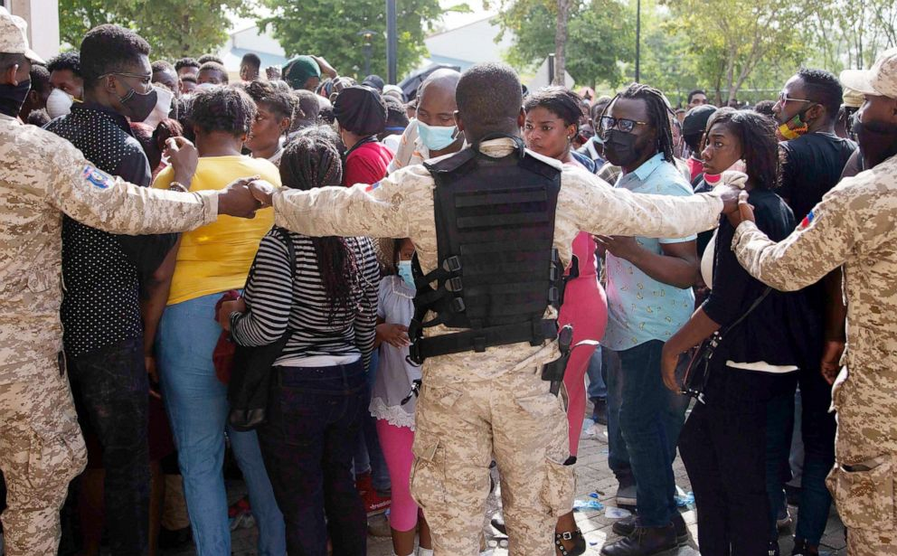 PHOTO: Haitian Police holds hands forming a cordon in front of the U.S. Embassy in Port-au-Prince, Haiti,, July 9, 2021.