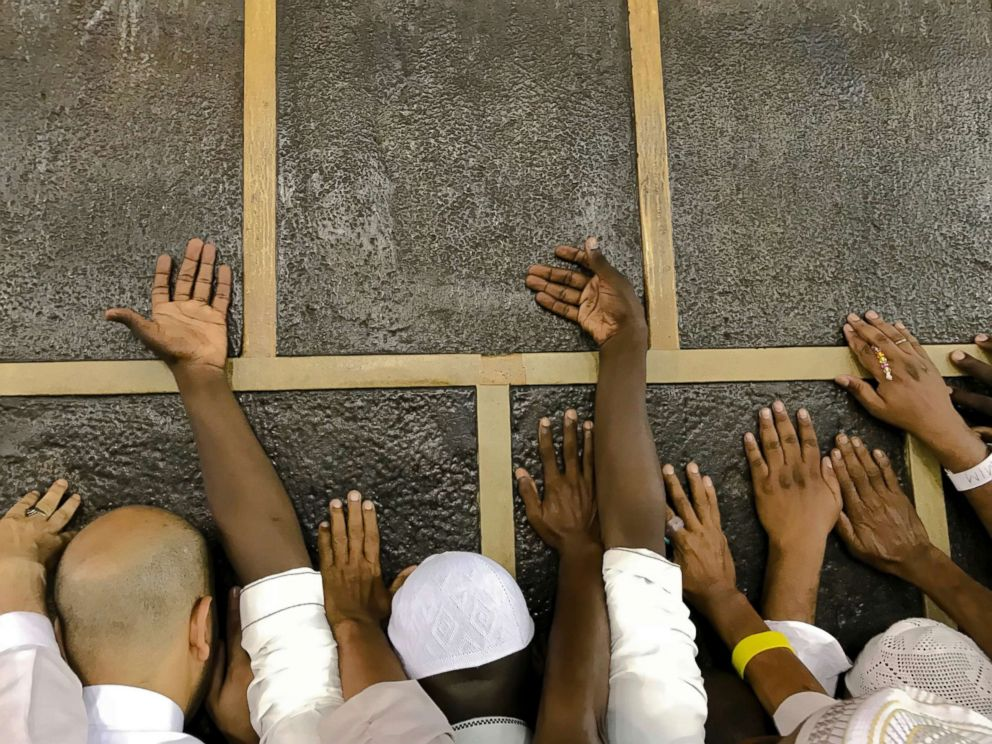 PHOTO: Muslim pilgrims touch the Kaaba stone, the cubic building at the Grand Mosque, as they pray ahead of the annual Hajj pilgrimage in the Muslim holy city of Mecca, Saudi Arabia, Aug. 17, 2018.