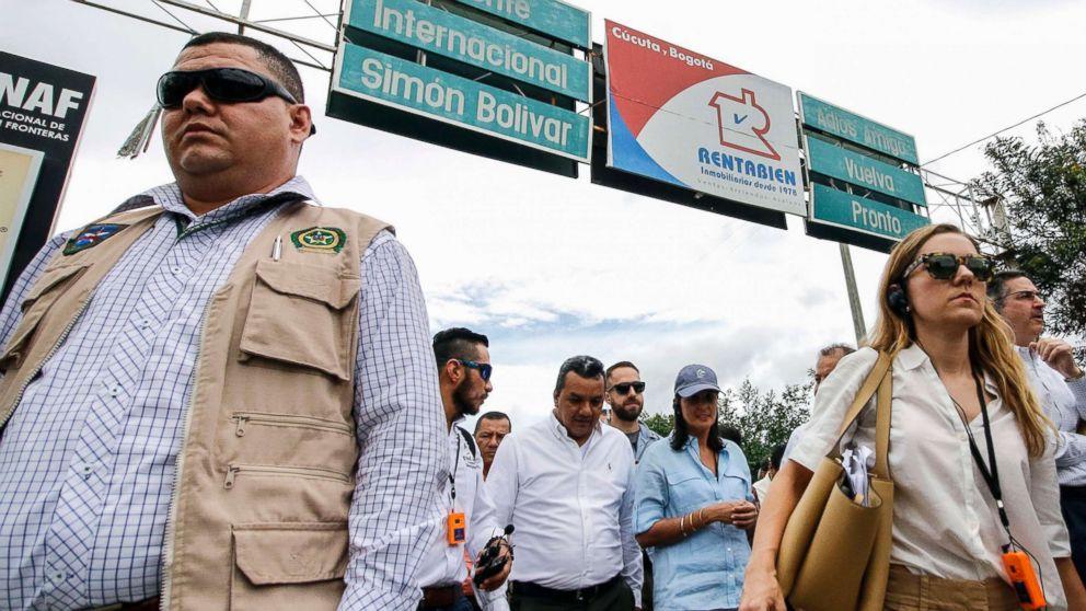 U.S. Ambassador to the United Nations Nikki Haley, center in blue hat, walks on the Simon Bolivar International Bridge in Cucuta, Colombia, on the border with Venezuela, August 8, 2018.