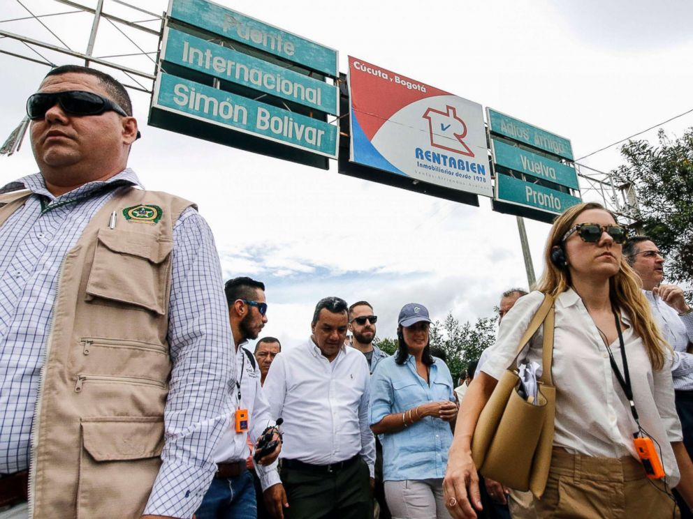 PHOTO: U.S. Ambassador to the United Nations Nikki Haley, center in blue hat, walks on the Simon Bolivar International Bridge in Cucuta, Colombia, on the border with Venezuela, August 8, 2018.