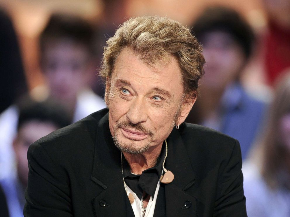 PHOTO: Johnny Hallyday attends the TV broadcast show Le Grand Journal on Canal + TV channel in Paris, March 28, 2011.