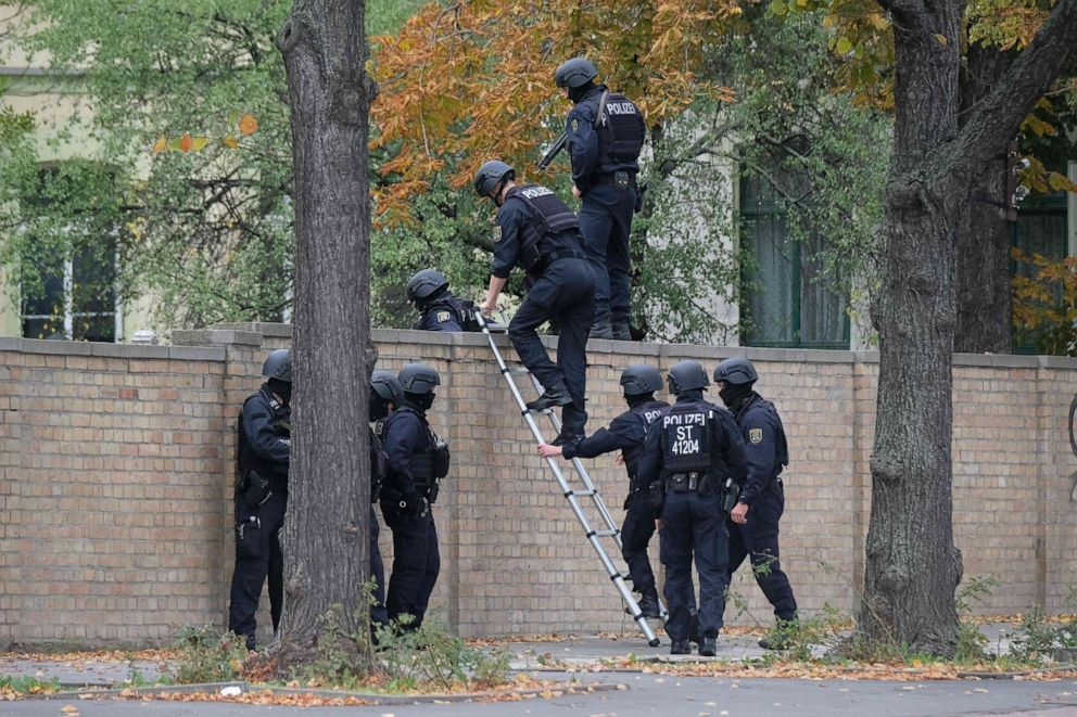 PHOTO: Policemen climb over a wall close to the site of a shooting in Halle an der Saale, eastern Germany, on Oct. 9, 2019.