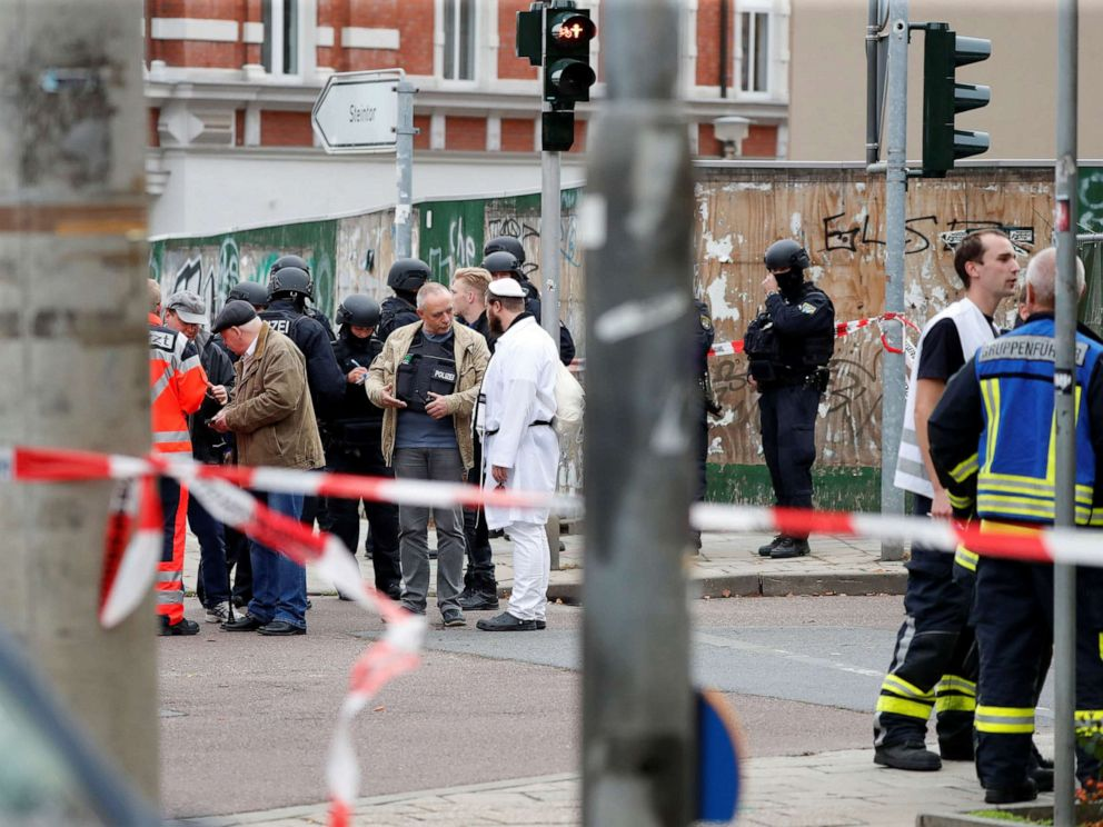 PHOTO: A police officer speaks with a Jewish man near the site of a shooting, in which two people were killed, in Halle, Germany, Oct. 9, 2019.