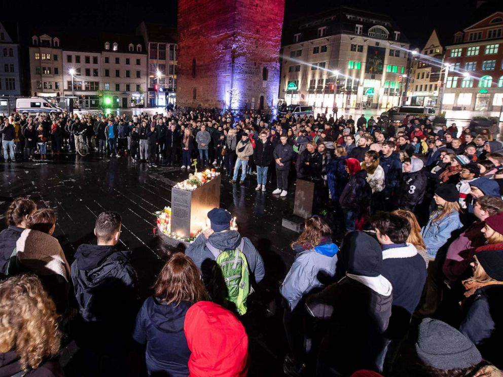 PHOTO: Mourners stand in front of the Red Tower on the market square in Halle, Germany, Oct. 9. 2019.
