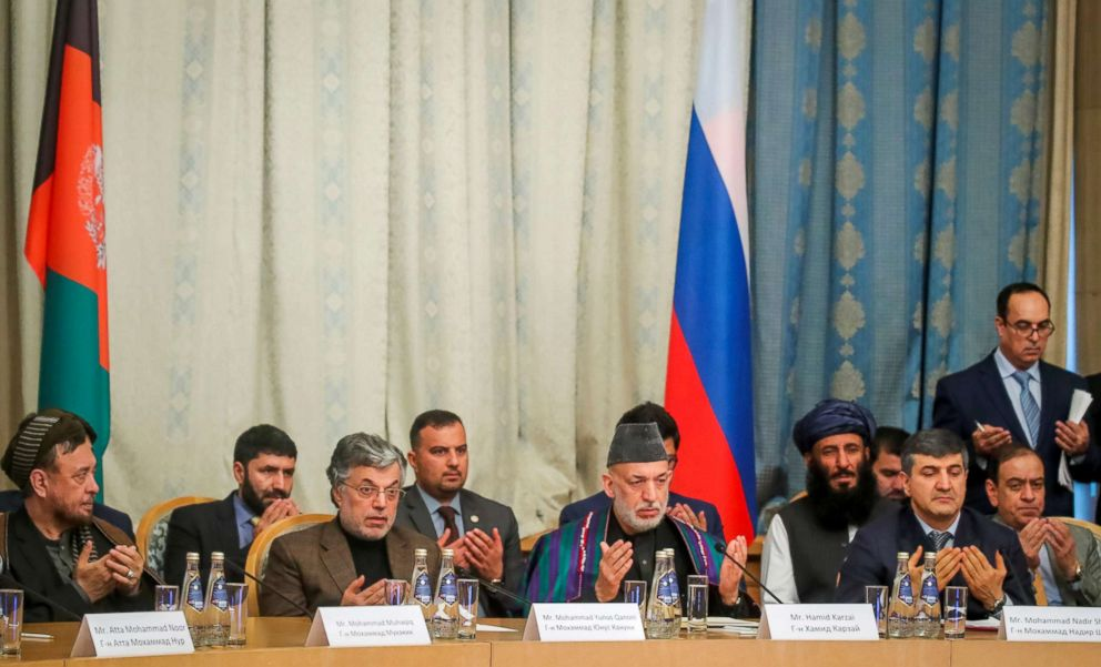 Afghan former President Hamid Karzai and other participants pray during a conference arranged by the Afghan diaspora in Moscow, Feb. 5, 2019.