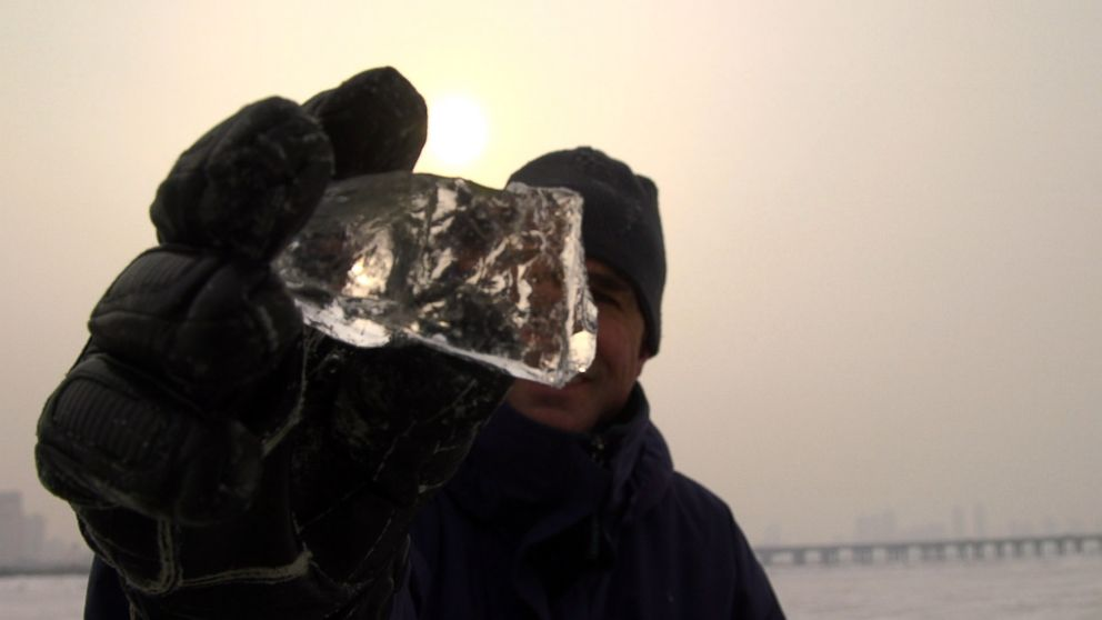 PHOTO: Bob Woodruff holds a diamond of ice on the frozen Songhua River in China.