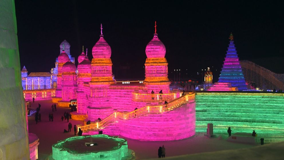 PHOTO: The ice buildings at the Harbin International Ice and Snow Festival are lit up by LED lights of changing colors.