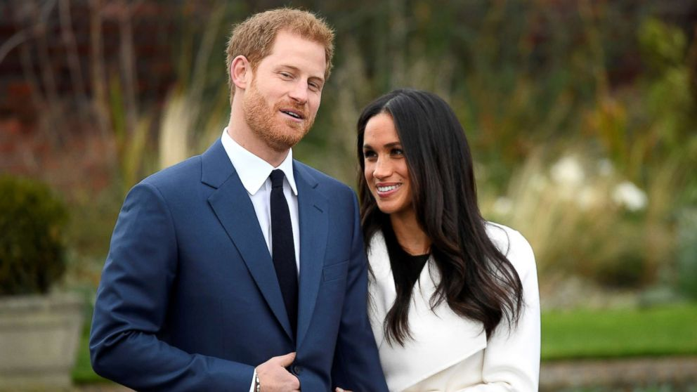 Britain's Prince Harry poses with Meghan Markle in the Sunken Garden of Kensington Palace, London, Nov. 27, 2017.