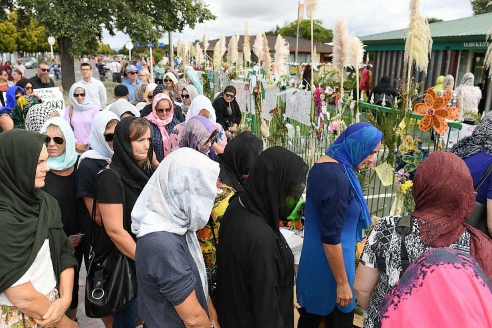 PHOTO: Women wearing headscarves are invited into the grounds of the Hastings Mosque before prayers on March 22, 2019 in Hastings, New Zealand.