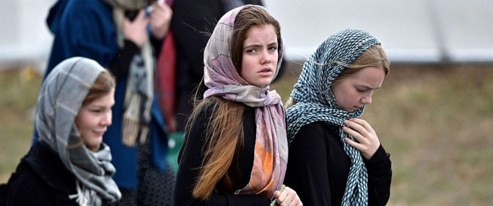 PHOTO: Residents and schoolchildren wearing headscarves arrive for the funeral of those killed in New Zealands twin mosque attacks at Memorial Park cemetery in Christchurch, March 21, 2019.