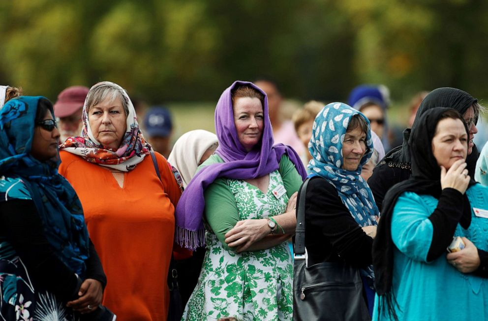 PHOTO: Women wearing headscarves as tribute to the victims of the mosque attacks are seen before prayers at Hagley Park outside Al-Noor mosque in Christchurch, New Zealand, March 22, 2019.