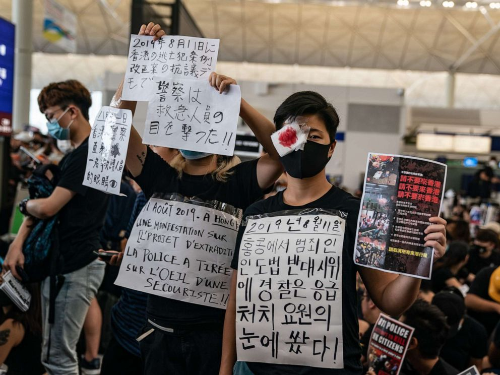 PHOTO: Protesters hold placards as they occupy the arrival hall of the Hong Kong International Airport during a demonstration on Aug. 12, 2019.