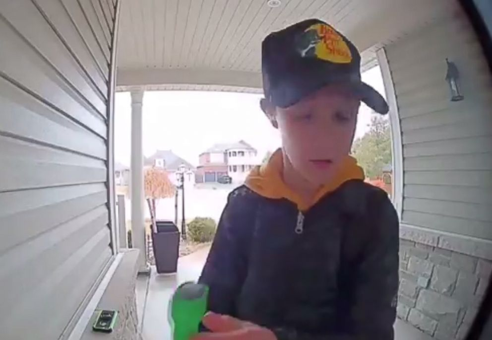 PHOTO: A video shared on Twitter on April 11, 2018 shows a young boy examining and then kissing a hockey stick left in tribute to those who died in the Humboldt Broncos bus crash earlier in the month.