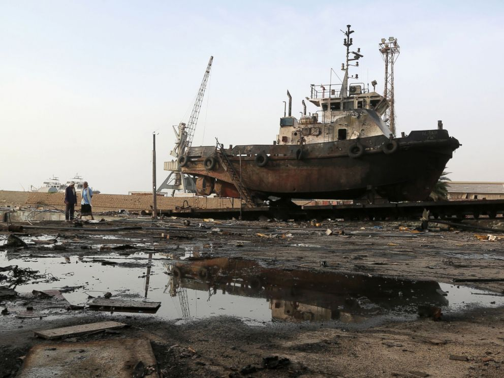 PHOTO: Workers inspect damages at the site of an air strike on the maintenance hub at the Hodeidah port, May 27, 2018.