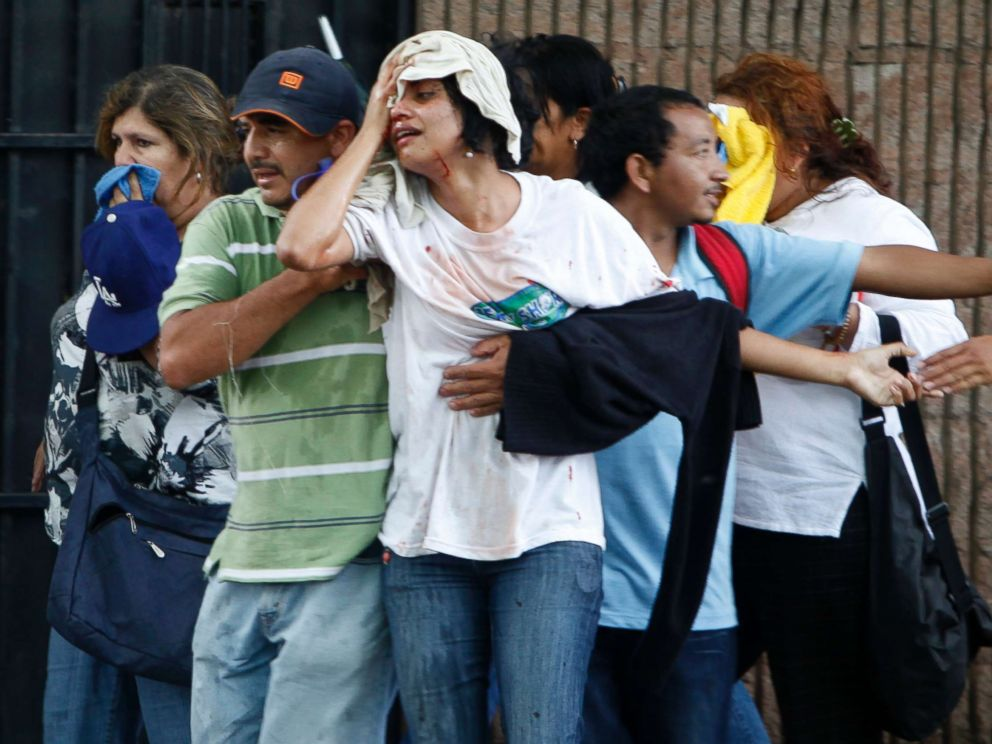 PHOTO: A wounded woman is taken away after violence broke out between soldiers and police against supporters of ousted Honduras President Manuel Zelaya near the presidential residence in Tegucigalpa, June 29, 2009.