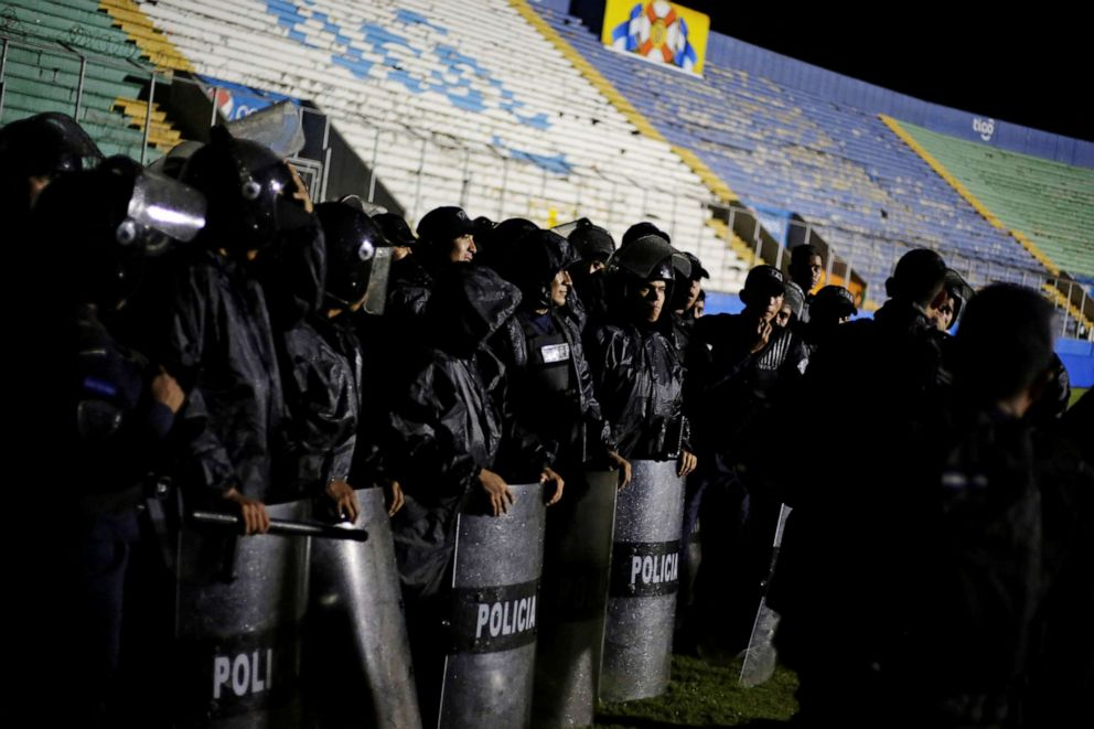 PHOTO: Police officers keep watch after three people died in riots before a soccer match when the fans attacked a bus carrying one of the teams, inside the National Stadium in Tegucigalpa, Honduras, on Saturday, Aug. 17, 2019.
