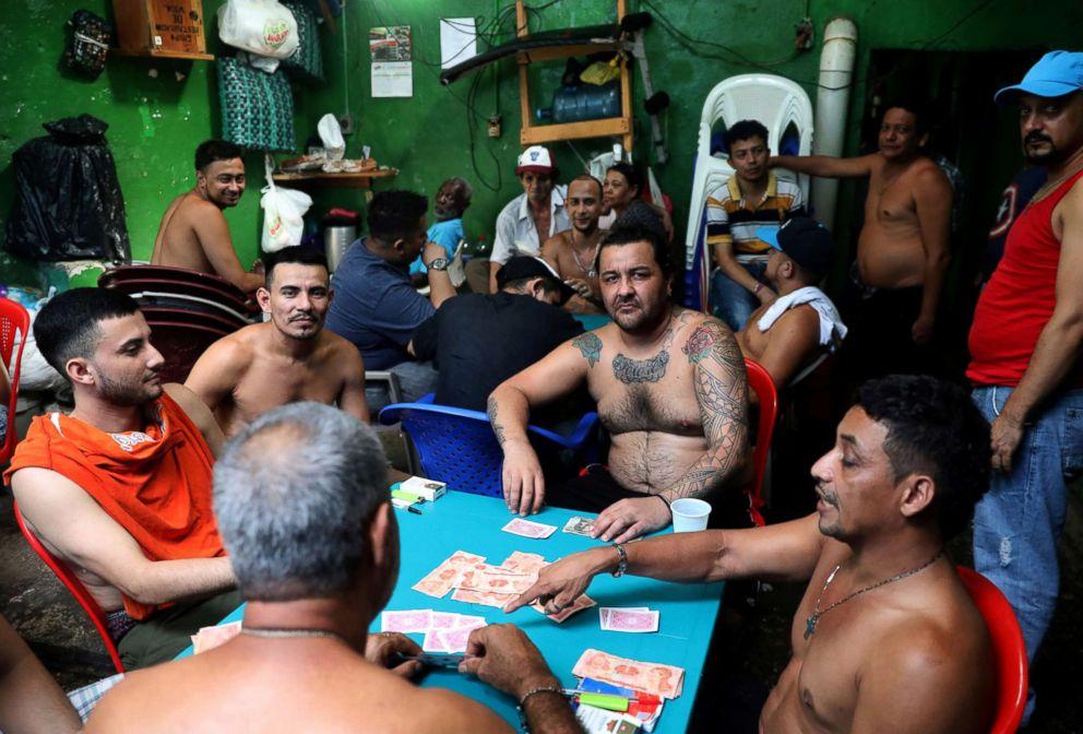 PHOTO: Prisoners play cards in Puerto Cortes jail, Honduras, July 31, 2018.