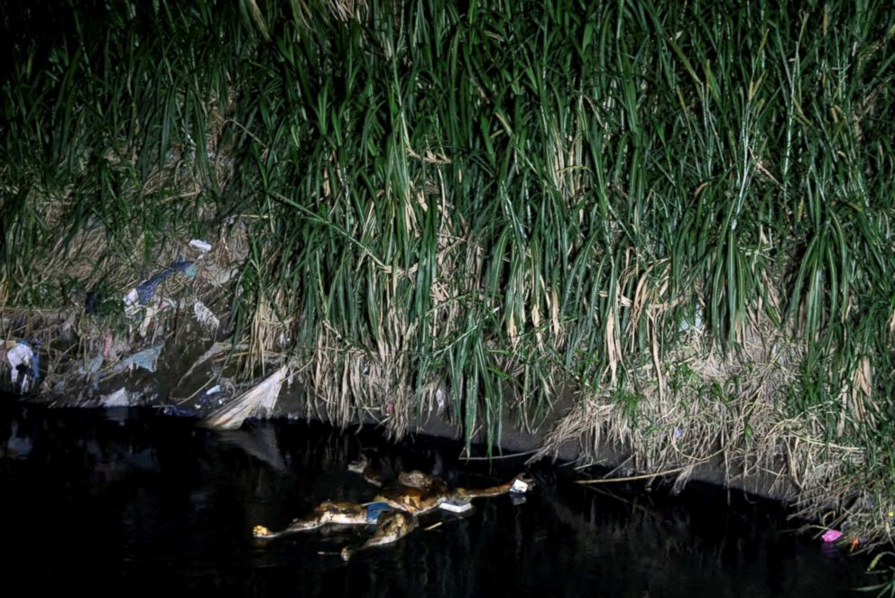 PHOTO: The body of man killed in gang violence floats in a canal in San Pedro Sula, Honduras, Sept 24, 2018.