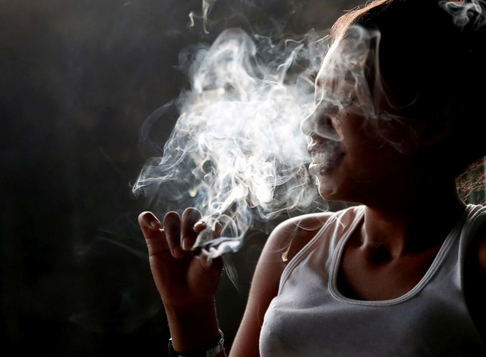 PHOTO: A 15-year-old girl smokes marijuana with MS-13 gang members in a house in San Pedro Sula, Honduras, Sept. 29, 2018.