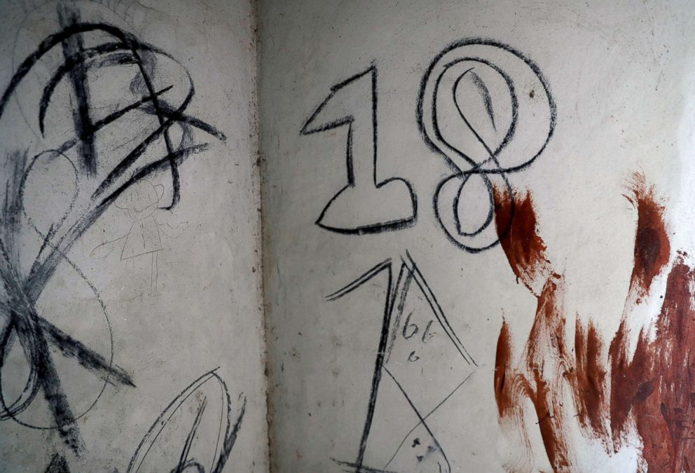 PHOTO: Blood is seen on a wall next to Barrio-18 graffiti in a so-called Crazy House in San Pedro Sula, Honduras, Sept. 27, 2018.