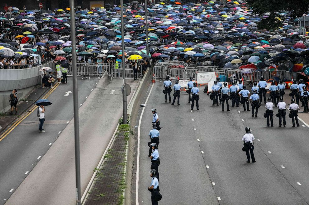 PHOTO: Police man a road as protesters attend a rally against a controversial extradition law proposal outside the government headquarters in Hong Kong, June 12, 2019.