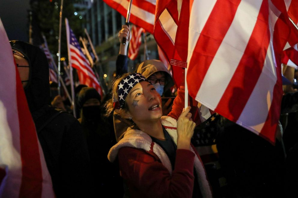 PHOTO: Protester holds a U.S. flag as she attends a rally in Hong Kong, China, Nov. 28, 2019.