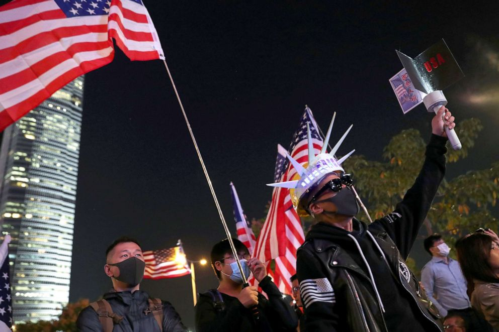 PHOTO: Demonstrators holding U.S. flags attend a rally in Hong Kong, Nov. 28, 2019.