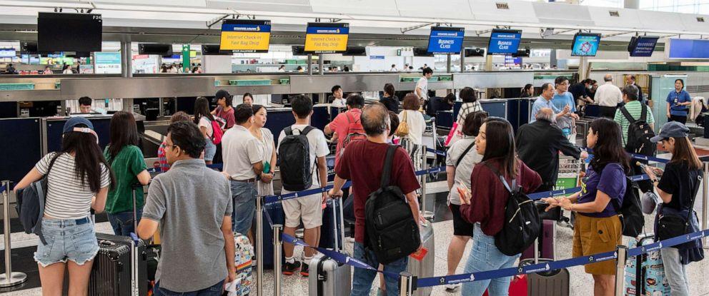 PHOTO: Passengers line up at check in counters at Hong Kong International Airport, Hong Kong, China, August 14, 2019.