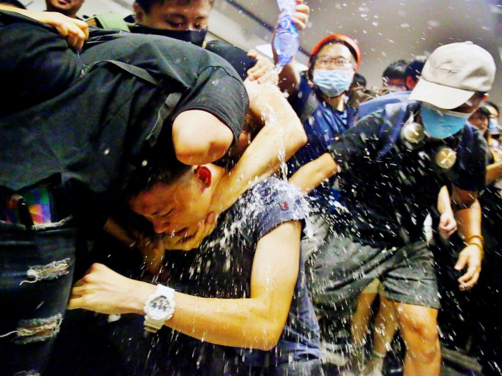 PHOTO: Protesters swarm a man who is suspected of being an undercover policeman at Hong Kong International Airport, Aug. 13, 2019.