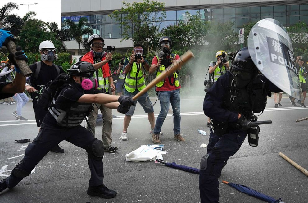 PHOTO: Police and demonstrators clash during a protest in Hong Kong, Saturday, Aug. 24, 2019.
