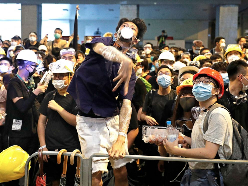 PHOTO:A protester throws eggs to police headquarters in Hong Kong, June 21, 2019.