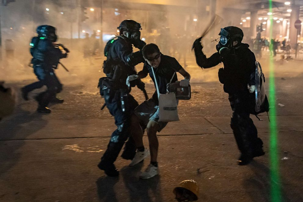 PHOTO: Riot police detain a protester during a demonstration, Aug. 5, 2019, in Hong Kong, China.