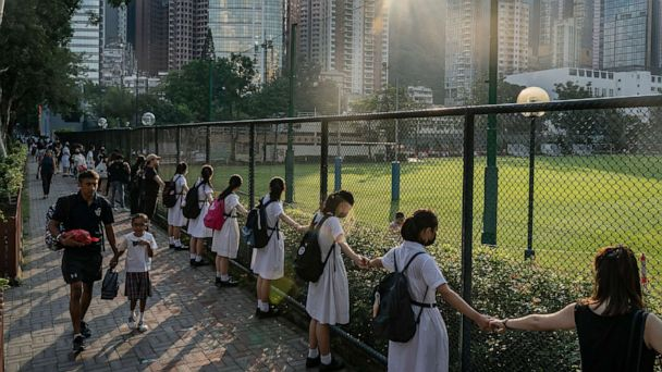 Holding hands, students show their support for pro-democracy protests in Hong Kong