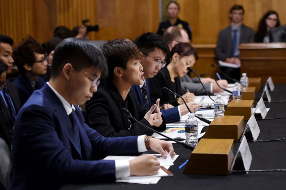 PHOTO: Joshua Wong listens as Denise Ho (C), pro-Democracy activist and Cantopop singer testifies before the Congressional-Executive Commission on China about the pro-democracy movement in Hong Kong, on September 17, 2019, in Washington, D.C.s
