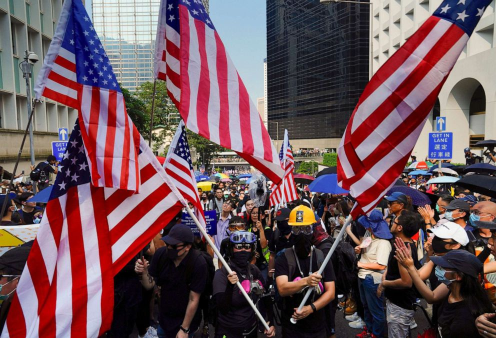 PHOTO: Protesters shout slogans and wave U.S. flags as they march from Chater Garden to the U.S. Consulate in Hong Kong, Sunday, Sept. 8, 2019.