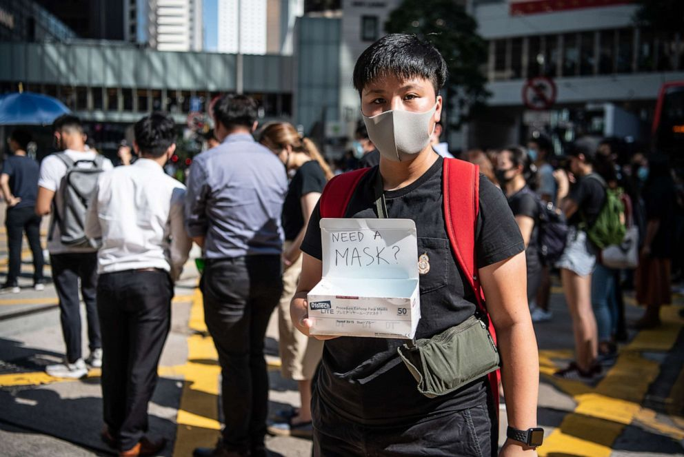 PHOTO: A woman offers masks during a protest against a government ban on face masks, Oct. 4, 2019 in Hong Kong, China.