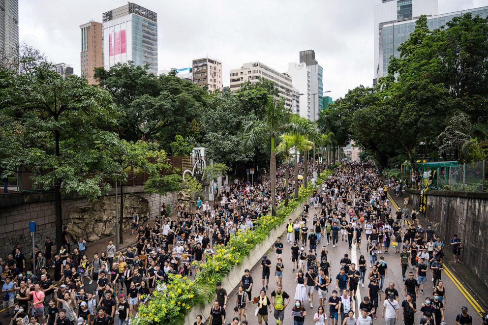 PHOTO: Protesters march towards the West Kowloon railway station during a protest against the proposed extradition bill on July 7, 2019, in Hong Kong, China.