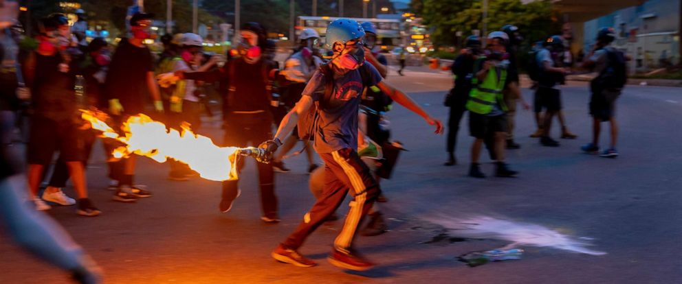 PHOTO: A protester throws a flammable object during a protest standing off against riot police in the Tai Wei district on Saturday, Aug. 10, 2019 in Hong Kong.