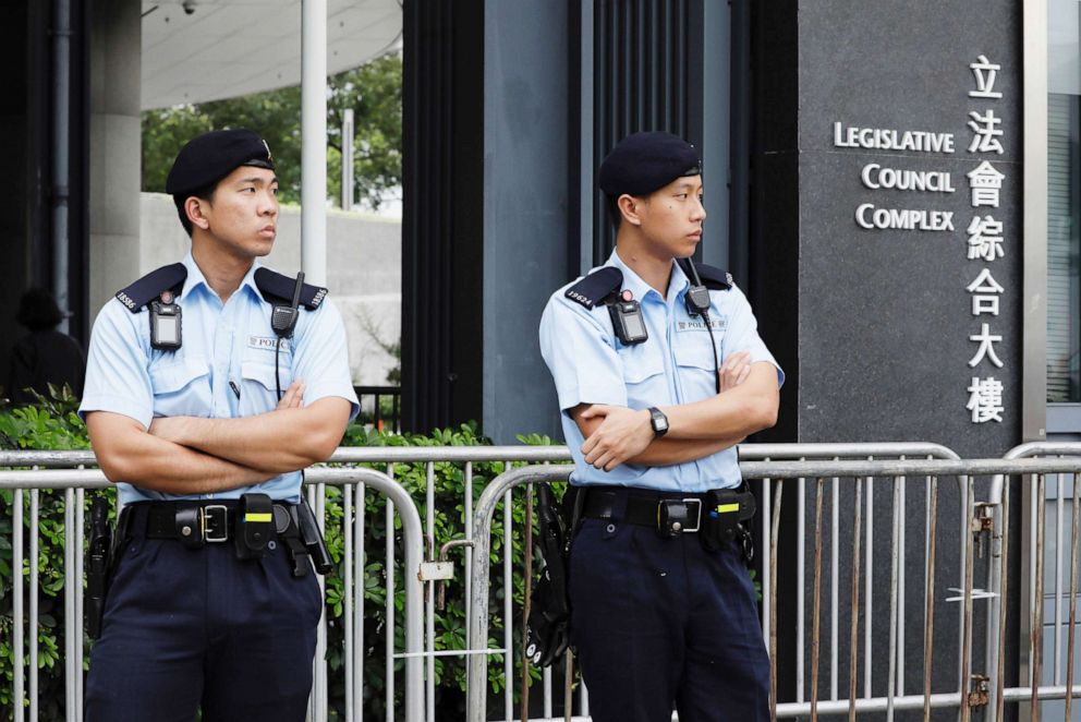 PHOTO: Police stand guard fencing surrounding the Legislative Council to help block protesters during upcoming meetings on the governments extradition law bill, in Hong Kong, Tuesday, June 11, 2019.
