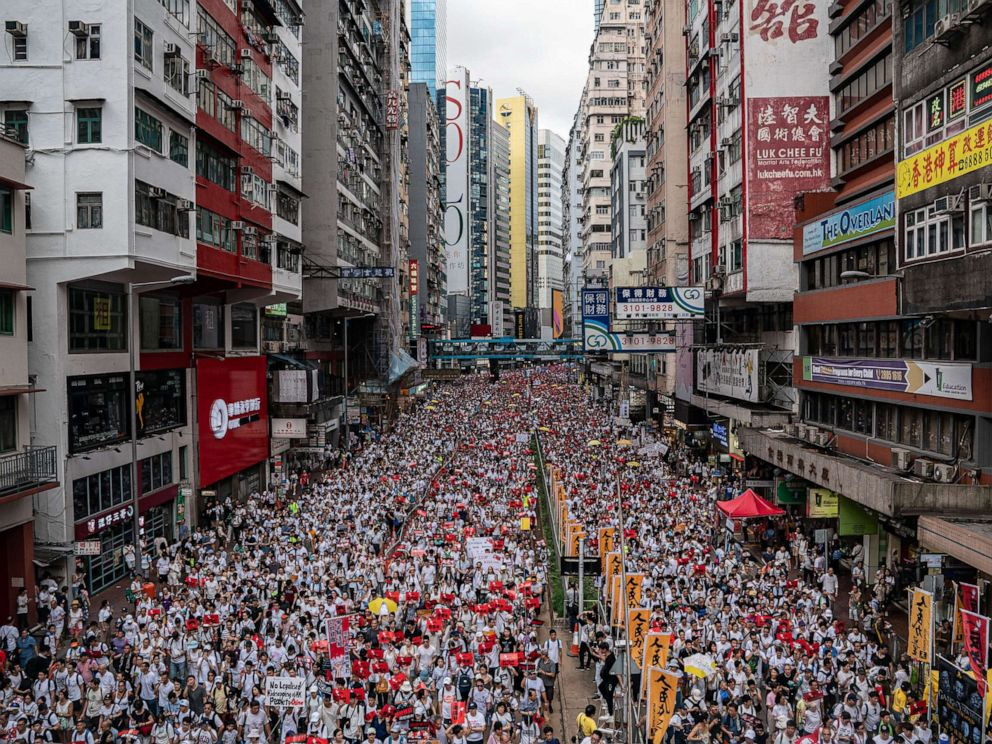 PHOTO: Protesters march on a street during a rally against the extradition law proposal, June 9, 2019, in Hong Kong.