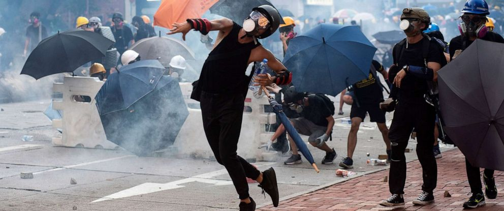 PHOTO: Anti-extradition protesters throw bricks after police fired tear gas at them during clashes in Wong Tai Shin area in Hong Kong, China, Aug. 5, 2019.