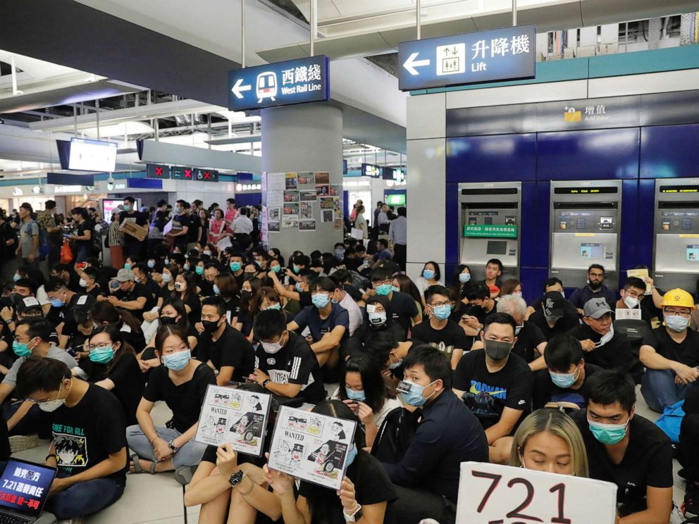 PHOTO: Demonstrators sit during a protest at the Yuen Long MTR station, where demonstrators and others were violently attacked by men in white T-shirts following an earlier protest in July, in Hong Kong, Aug. 21, 2019.