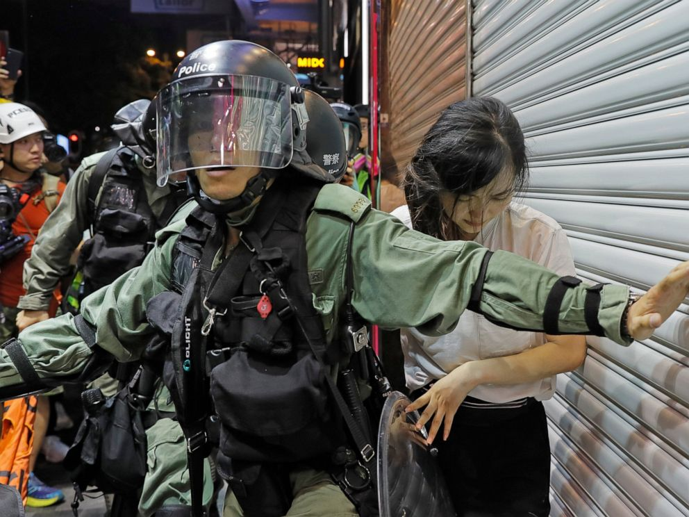 PHOTO: Police detain a girl during a confrontation in Hong Kong on Saturday, Aug. 10, 2019.