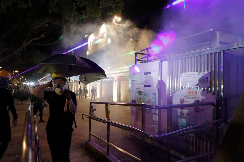 PHOTO: Protesters react to tear gas fired near the Tsim Sha Tsui police station in Hong Kong on Saturday, Aug. 10, 2019.